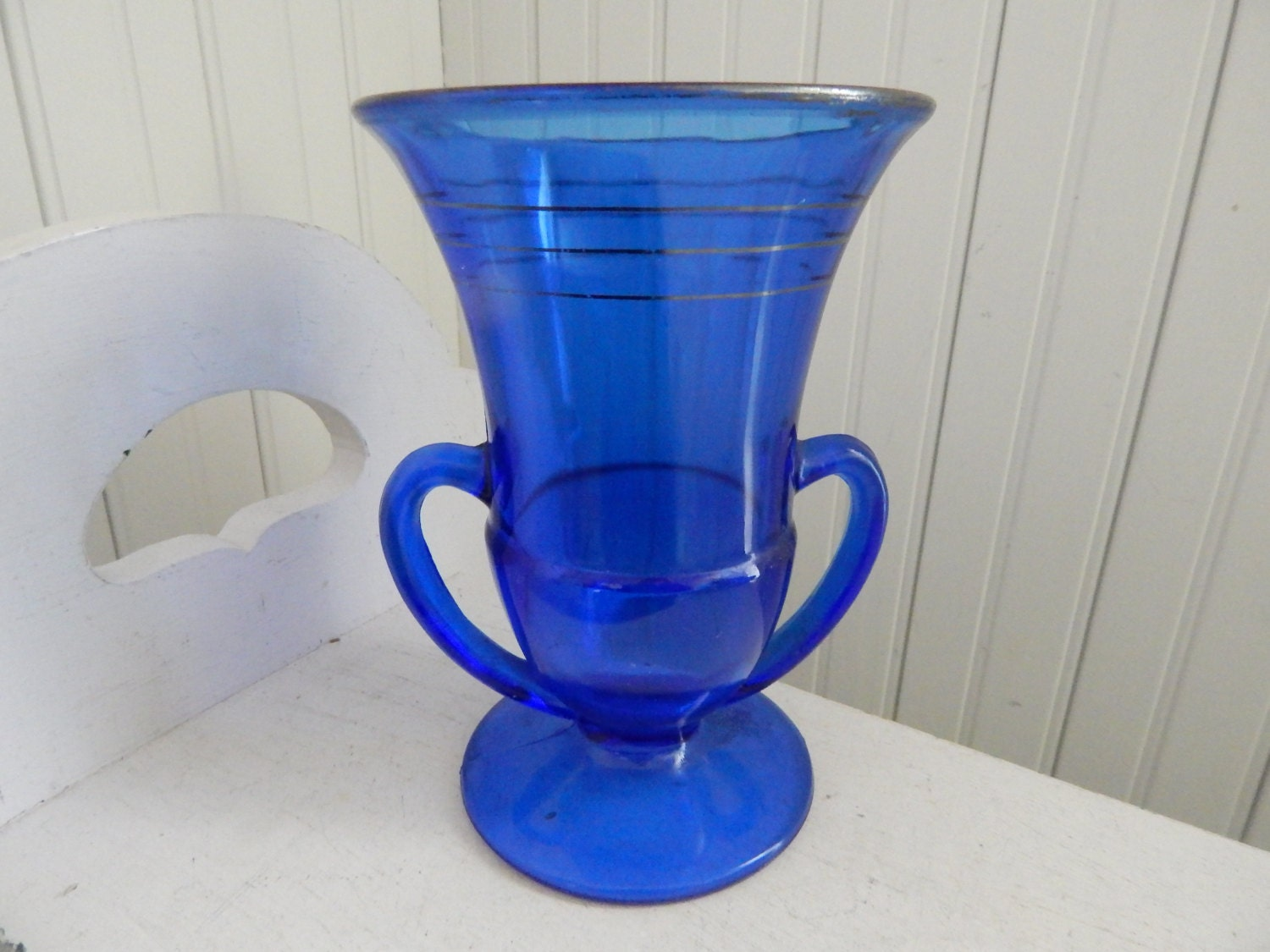 Cobalt blue depression glass double handled footed vase description simply stunning cobalt blue depression glass double handled footed vase floridaeventfo Image collections
