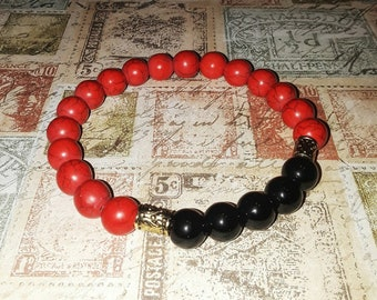 Red marbled and black bead bracelet