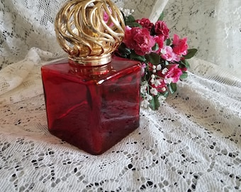 Large ruby red perfume decanter with gold lattice top for your consideration