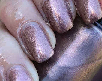 McKini  taupey rose gold foil effect nail polish