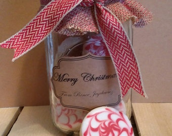 Burlap & Mason Jar filled with cookies decorated like peppermint candies!