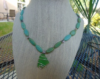 "1"" Green Sea glass Wire wrapped Pendant, on a 23"" green beaded necklace ."