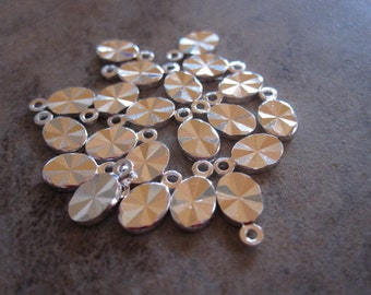 20 Drops, silver-plated brass, 6x4mm double-sided diamond-cut oval. JD185