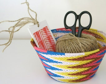Colourful chevron-patterned reclaimed telephone-wire basket