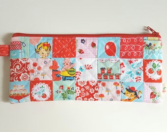 Handmade quilted Pencil case. Red, Pink and blue cotton fabric. Patchwork zippy pouch.