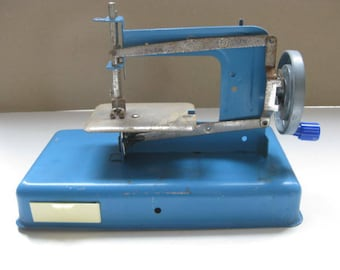 Vintage French blue metal toy sewing machine.