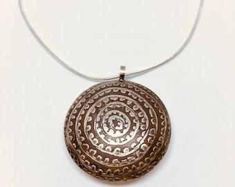 Circles and dots etched lentil pendant