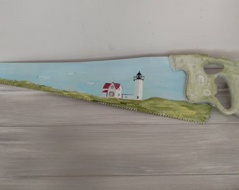 Nubble Lighthouse painted saw,vintage saw lighthouse,saw coastal painted lighthouse,Maine lighthouse,coastal Maine lighthouse,painted saw