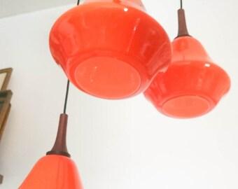 Vintage scandinavian chandelier with three lights orange glass pendants design 1970's teck and bronze mount