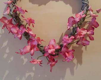 Bleached willow heart with pink/ white orchids.