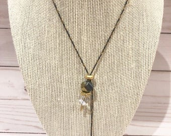 Glass crystals in black and clear wrapped in metal chain
