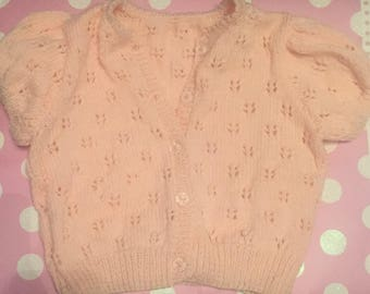 1 - 2 Year Old Girls Peach Handknitted Short Sleeved Cardigan