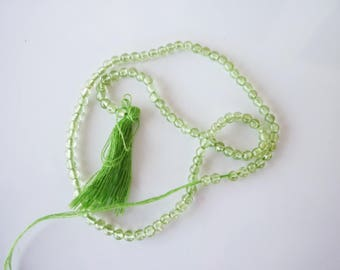 1 strand of green 2mm glass beads