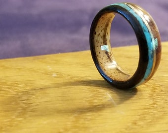 Bent wood ring with ebony, redwood burl, zebrawood, turquoise, and gold