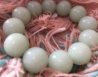 White jade bracelet with a taint of green