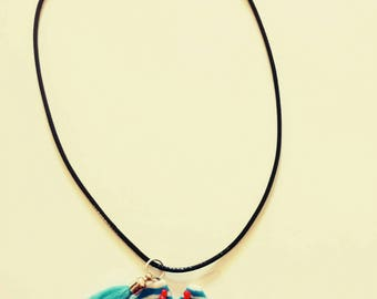 Necklace with polymer clay pendant tee shirt and tassel