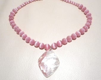 Pink narurelles cat's eye beaded necklace and its mother of Pearl