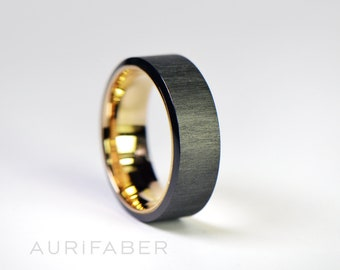 Wide zirconium ring with gold inside. Black zirconium band with yellow gold, rosé gold or white gold. Two-tone band. 7mm wide.