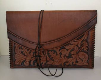 Handmade, traditionally carved Leather Envelope style Clutch bag