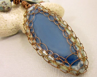 Wire Netted Blue Agate Slice Pendant, Blue Agate and Speckled Blue Bead Leather Cord Necklace and Coiled Copper Ends and Copper Toggle Clasp