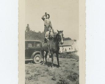 Drinking & Riding: Vintage Snapshot Photo [83660]