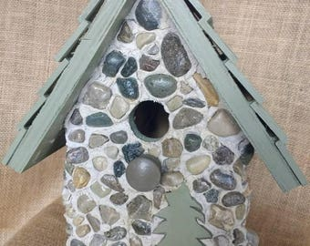 Sage green stone bird house with easy clean out. Hanger atop and painted hardwood shingles.