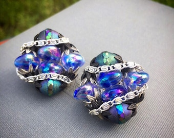 1960s Opaque blue black, rainbow metallic and glass bead Hobé clip on earrings