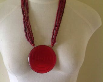 Large red beaded pendant necklace, red bead neckace, red resin necklace, large circular pendant necklace, geometric pendant.