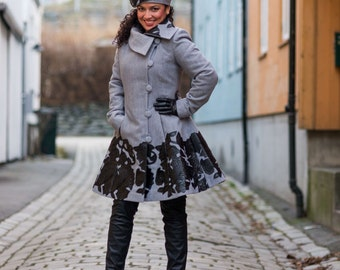 winter coat, very feminine and stylish design, in grey fabric with black leather imitation details