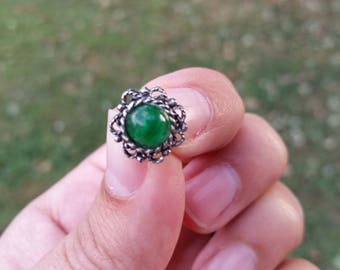 Green and silver tie tack