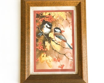 Vintage wooden frame with bird picture