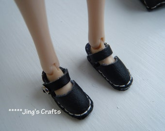 MOMOKO a pair of black leather shoes by Jing's Crafts