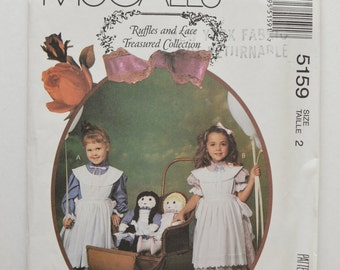"""1990s UNCUT McCall's Ruffles and Lace Pattern 5159 Girls Short or Long Sleeve Dress, Pinafore & Matching Clothes For 22"""" Doll Size 2"""