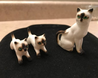 Vintage miniature Siamese cat figurines