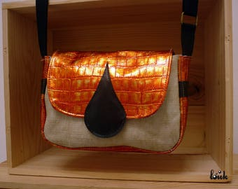 Small ivory, orange and black leather bag