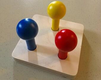 Coloured balls on dowels