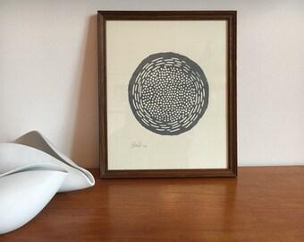 Abstract circular grey modernist lino print in Vintage dark wood frame