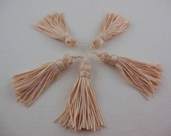 A Bisque color rayon thread tassel