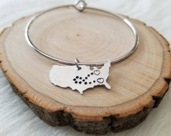 "Hand Stamped ""Two Hearts Connected Across the United States"" Metal Bangle Bracelet with Charm"