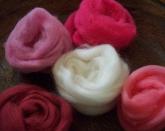 Hand dyed wools, pinks and reds   wool roving sampler.