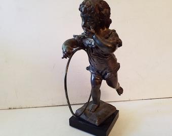 Bronze, child with hoop, see description