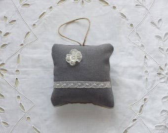 Small decorative pillow with lace to hang
