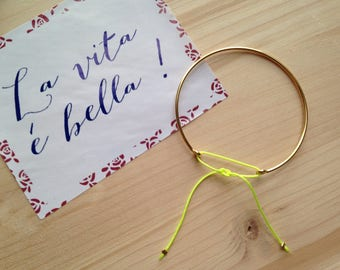 Bangle is plated 14 k - neon yellow cord