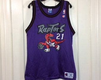 1990s Marcus Camby Toronto Raptors number 21 NBA Basketball team purple Champion brand jersey tank top size 48, looks size 44