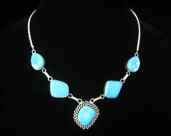 "Turquoise Color Stone Cabochon Bib Like Necklace.  Bright Silver Chain Necklace has 4 Large Cab Links & Loop Framed Cab Pendant.  19.25"" L"