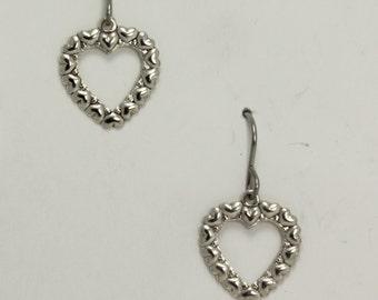 Silver heart earrings on hypoallergenic surgical steel ear wires