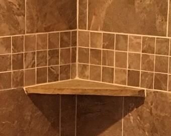 Stone shower corner shelf