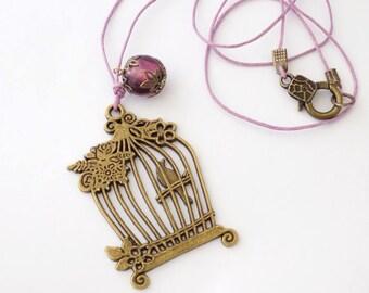 Mauve Bronze Necklace Cage Bird Pendant Plum Glass Bead