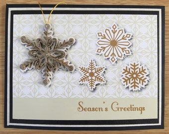 Holiday greeting card with removable quilled snowflake ornament