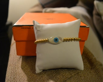 Circled and oval shaped evil eye bracelet.